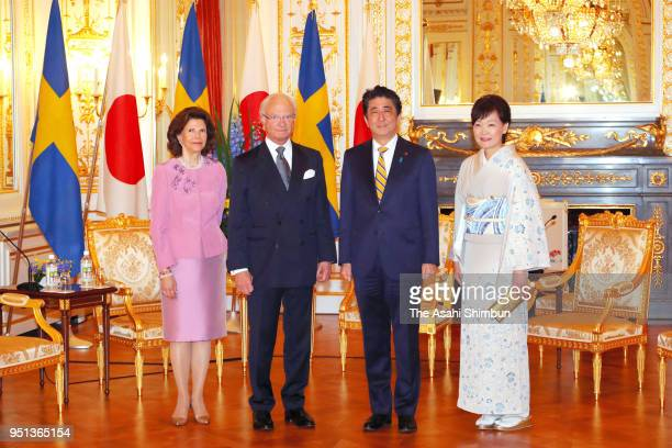 King Carl XVI Gustaf of Sweden, Queen Silvia of Sweden, Japanese Prime Minister Shinzo Abe and his wife Akie pose for photographs during their...
