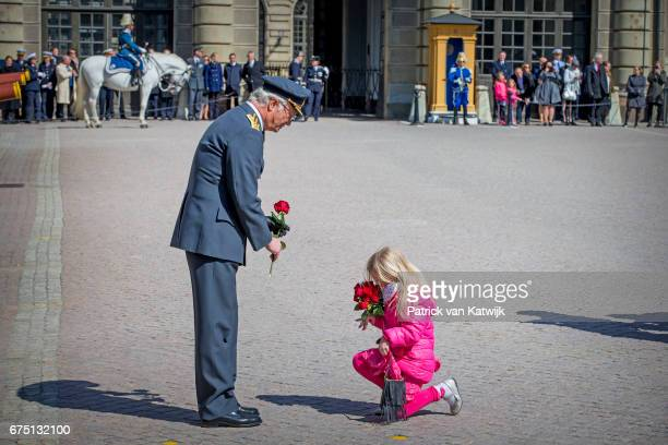 King Carl XVI Gustaf of Sweden receives flowers as he attends the birthday celebrations of the King at the Royal Palace on April 30 2017 in Stockholm...