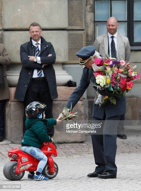 King Carl XVI Gustaf of Sweden receives flowers during the celebration of his 72nd birthday anniversary at the Royal Palace on April 30, 2018 in...