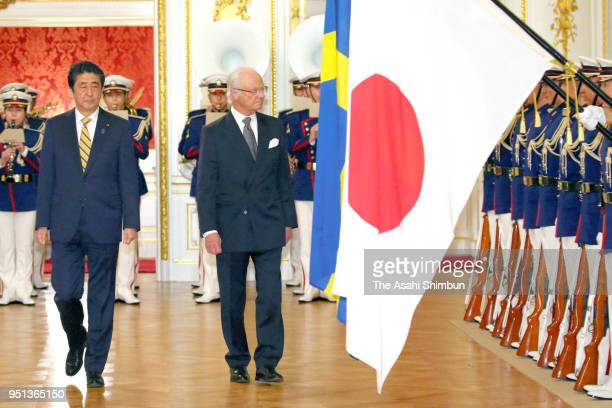 King Carl XVI Gustaf of Sweden reviews the honour guard at the Akasaka State Guest House on April 25, 2018 in Tokyo, Japan.