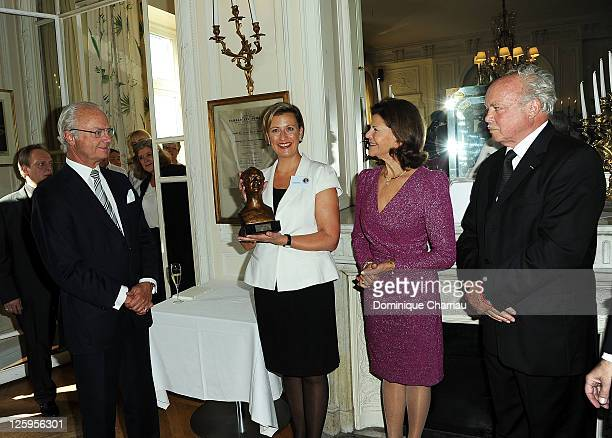 King Carl XVI Gustaf of Sweden Swedish Club Director Helena Brag Queen Silvia and sculptor Gudmar Olovsson attend Swedish Club 75th Anniversary at...
