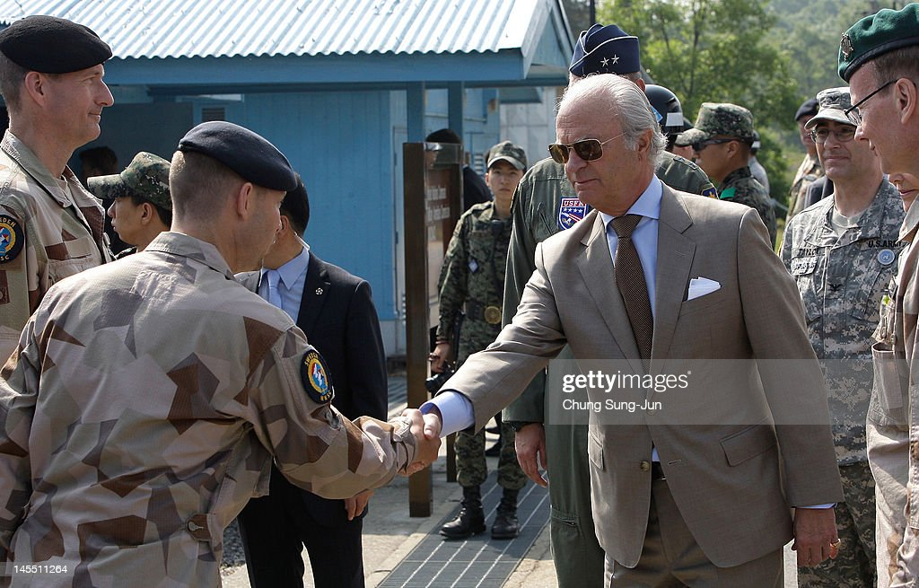 King Carl XVI Gustaf of Sweden visits at the border village of panmunjom between South and North Korea in the demilitarized zone (DMZ) on June 1, 2012, South Korea. The Swedish royals are on the four-day tour to South Korea.
