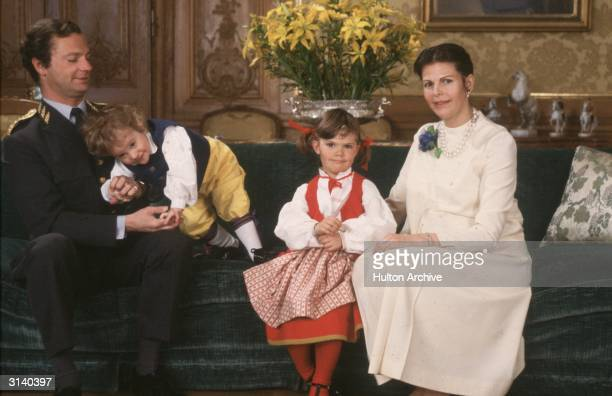 King Carl XVI Gustav of Sweden with Queen Silvia and their children Crown Princess Victoria and Prince Carl Philip on his 36th birthday