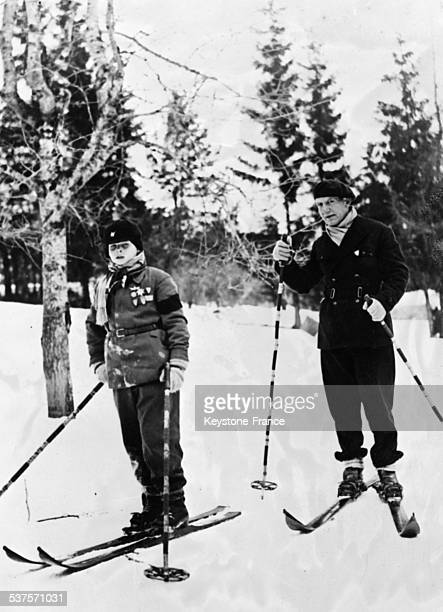 King Carol II of Romania accompanied by his son Michael I attends the military ski championships in Predeal Romania on February 4 1932
