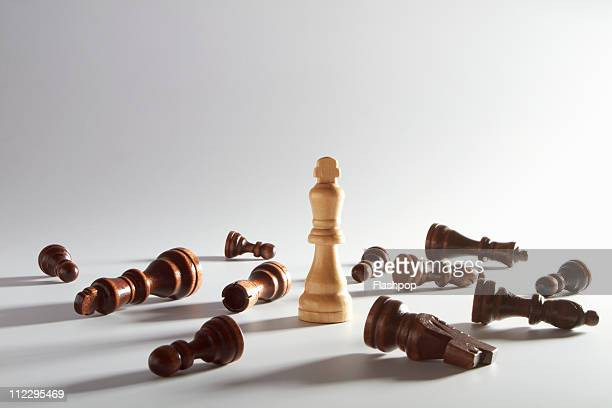 King chess piece surrounded by opponents