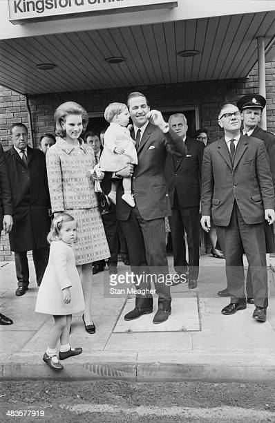 King Constantine and Queen Anne-Marie of Greece, with their children Prince Paul and Princess Alexia, arriving at London Airport on a royal visit,...