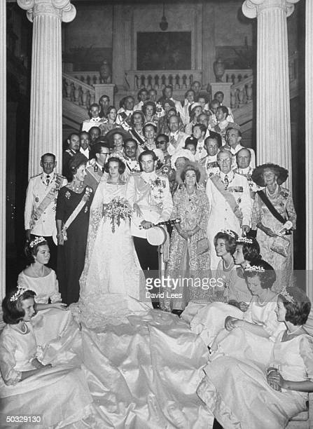 King Constantine and wife, formal wedding picture with royal families and guests, in the palace.