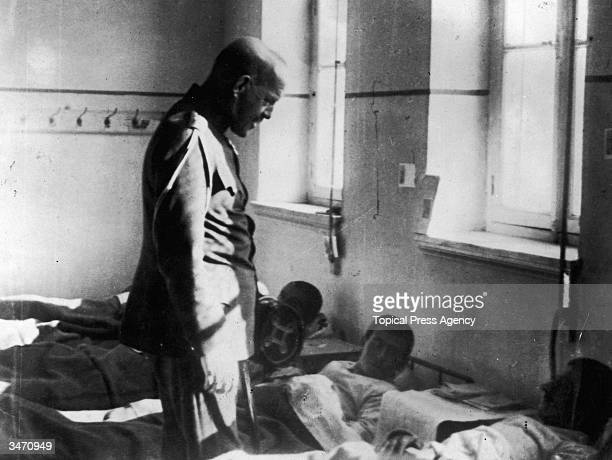 King Constantine I of Greece , nicknamed 'Tino' by the British, visits men injured during the Greek war with Turkey, April 1921.