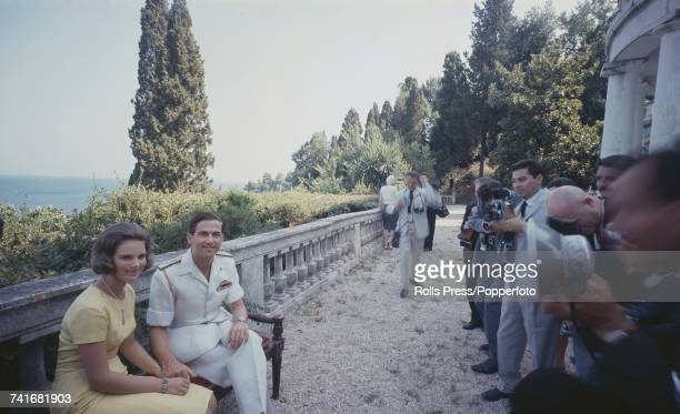 King Constantine II of Greece and his fiancee Princess AnneMarie of Denmark pictured together sitting in front of photographers at the Greek royal...