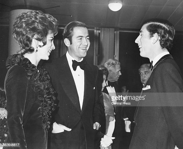 King Constantine of Greece and his wife Anne Marie talking to Prince Charles of Wales at a charity variety show Royal Festival Hall London November...