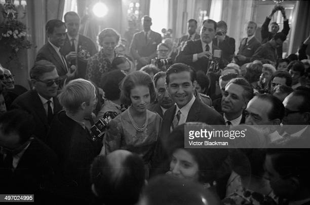King Constantine of Greece and his wife, Princess Anne Marie of Denmark, greeted by the press, September 9th 1964.