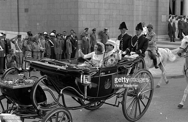 King Constantine of Greece and Princess Anne Marie of Denmark waving to crowds from a carriage following their wedding September 18th 1964