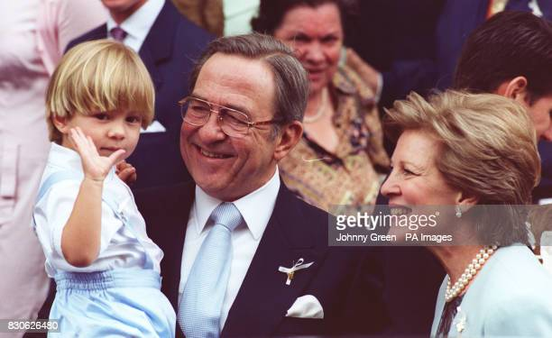 King Constantine of Greece and Queen AnneMarie with their grandchild Prince Constantine Alexios at the christening of nine month old Prince Achileas...