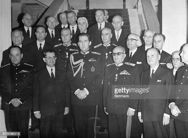 King Constantine of Greece poses with new government officials on April 26th at the Athens Royal Palace here From left are minister without Portfolio...
