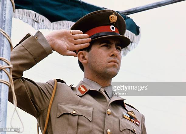 King Constantine of Greece saluting in military uniform.