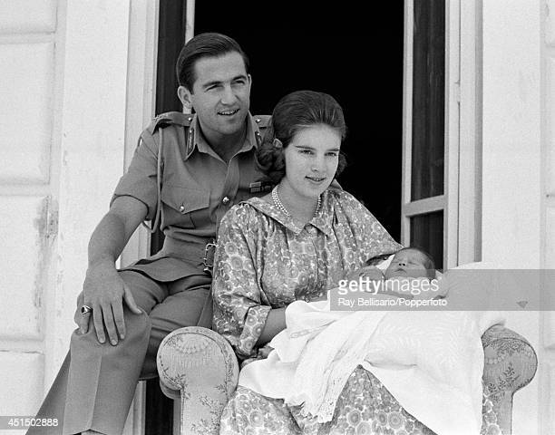 King Constantine of Greece with his Queen AnneMarie and baby daughter Princess Alexia at Mon Repos on Corfu 10th July 1965