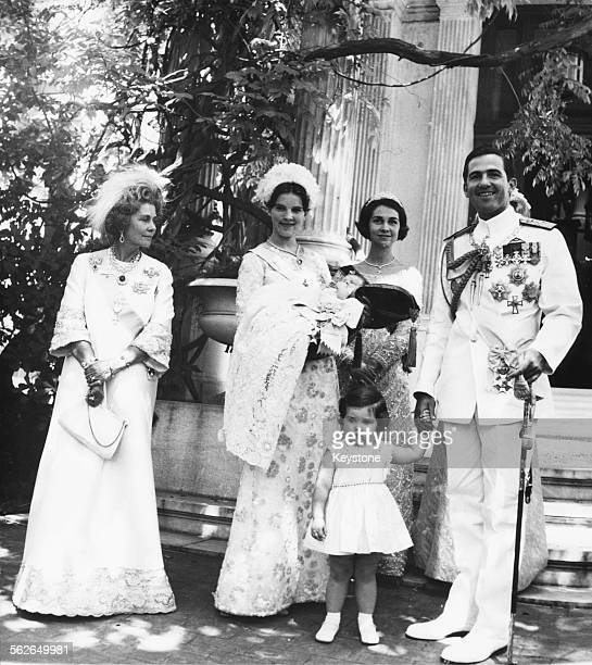 King Constantine of Greece with Queen Frederika and his family at the christening of his baby son Crown Prince Paul, outside Athens Cathedral, July...