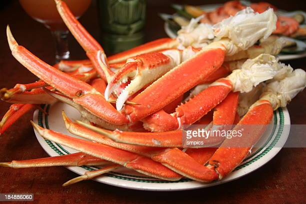 king crab legs - crab leg stock photos and pictures