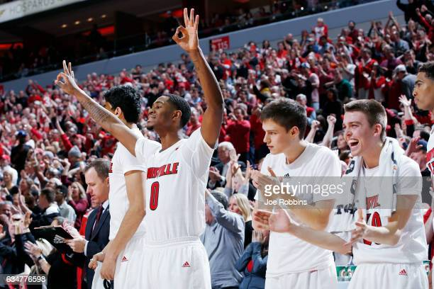J King David Levitch and Ryan McMahon of the Louisville Cardinals react from the bench in the second half of the game against the Miami Hurricanes at...