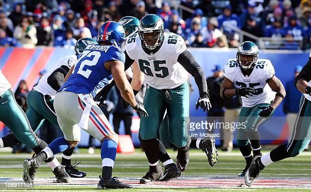 King Dunlap of the Philadelphia Eagles in action against Osi Umenyiora of the New York Giants at MetLife Stadium on December 30, 2012 in East...