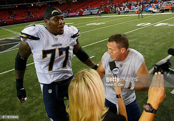 King Dunlap of the San Diego Chargers celebrates as he runs behind a post-game interview with Philip Rivers in their 33-30 overtime win over the...