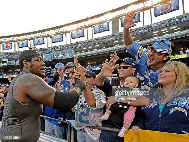 King Dunlap of the San Diego Chargers celebrates his team victory over the St. Louis Rams with fans during their NFL Game on November 23, 2014 in San...
