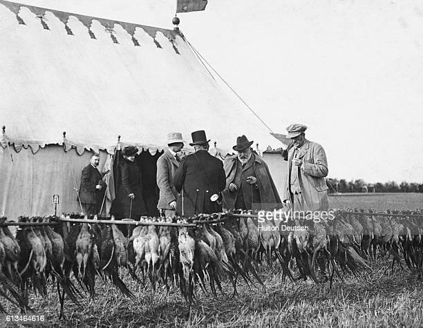 King Edward VII At A Shoot At Sandringham 1909 Inspecting the bag at Sherbourne near Sandringham [Blood sports]