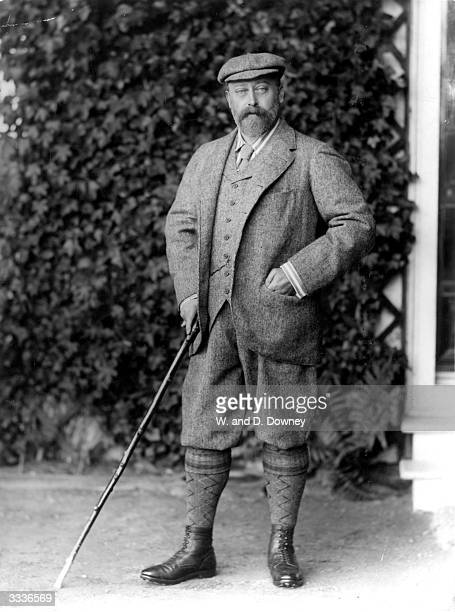 King Edward VII wearing knickerbockers and holding a cane.