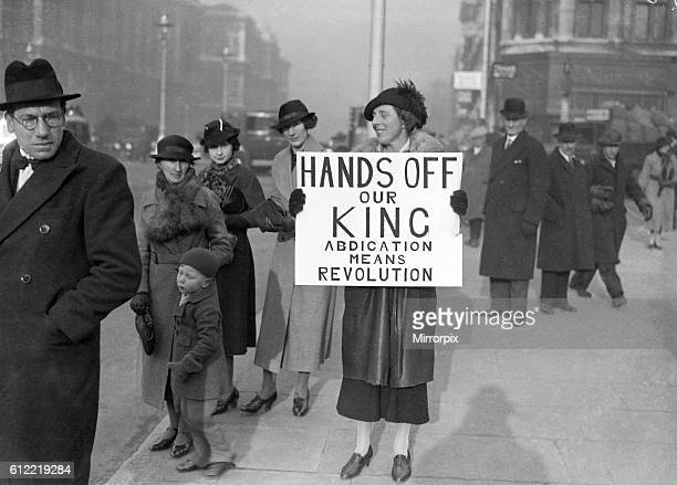 King Edward VIII Abdication Crisis December 1936. A woman holding a banner outside the Houses of Parliament. Banner reads: Hands Off Our King....