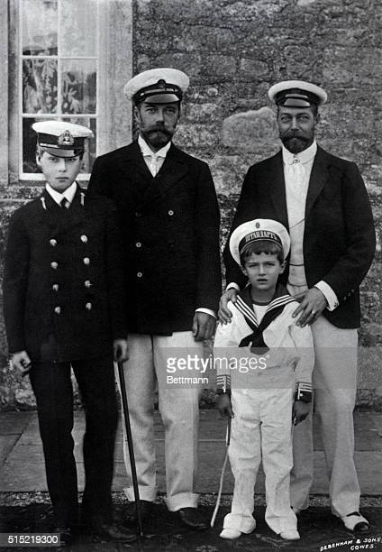 King Edward VIII and Nicholas II Emperor of Russia stand with their sons Prince George V and Czarevitch Alexei respectively at Cowes England