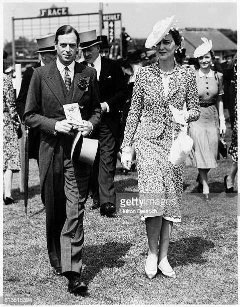 King Edward VIII and the Duchess of Windsor walk through the racing paddocks on the day of a big race