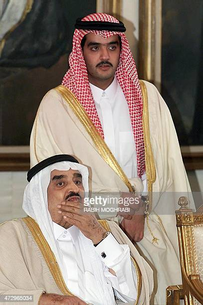 King Fahd Ibn Abdel Aziz and his son Abdel Aziz wait at Riyadh airport for the arrival of headsofstate arriving to participate 27 November 1999 in a...