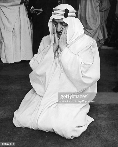 King Faisal ibn Abdul Aziz Al Saud of Saudi Arabia prays at London Central Mosque during a state visit to the UK, 12th May 1967.