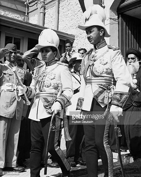 HM King Faisal II and his uncle HRH Prince Abdul Illah leave the Majlis al Nawab prior to his coronation ceremony The ceremony is taking place on...