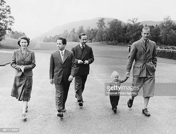 King Faisal II of Iraq and the Prince Regent walking in the grounds of Balmoral Castle in Scotland whilst a guest of Queen Elizabeth II 26th...
