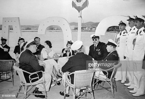 King Farouk of Egypt and Queen Narriman are guests of honor at the annual yacht and motorboat contests held by the Motor Yacht Club of Cannes and...