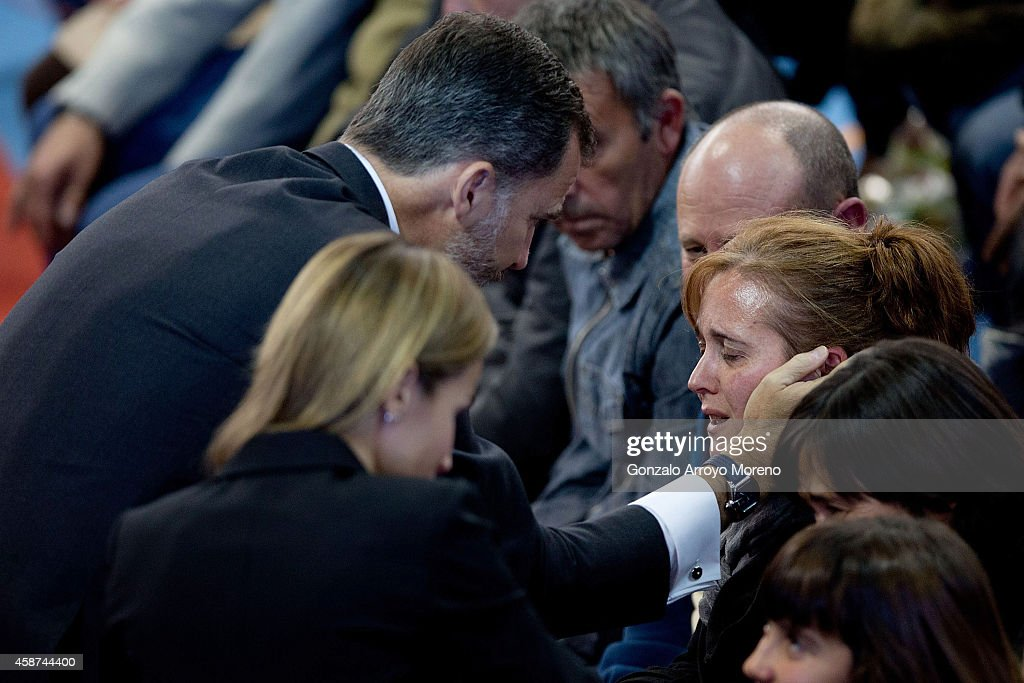 King Felipe (L) and Queen Letizia (R) of Spain give their condolence to relatives of the 14 victims death at a bus accident this weekend at Juan Valera pavilion on November 10, 2014 in Bullas, at Murcia province, Spain. More than 2 thousand people attend the funerals for the 14 victims who were killed after their bus fell 15 meters from the Calasparra road. The travellers were returning from Madrid to the Murcian town of Bullas after attending a religious ceremony at the Convent of the Barefoot Carmelites.