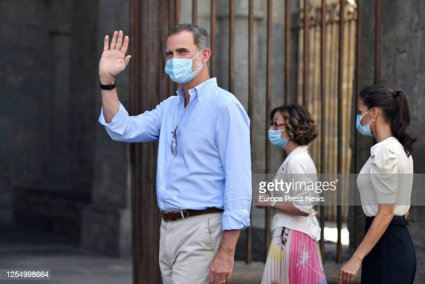 King Felipe of Spain and Queen Letizia of Spain are seen greet the neighbours during their walk through the historic centre of the Pyrenean city of...
