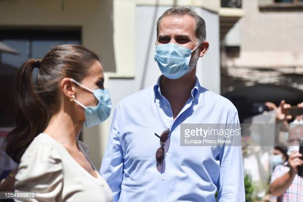 King Felipe of Spain and Queen Letizia of Spain are seen greeting the neighbours during their walk through the historic centre of the Pyrenean city...