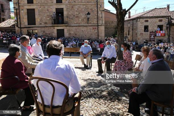 King Felipe of Spain and Queen Letizia of Spain are seen talking with some residents of the Soria town of Vinuesa on July 15 2020 in Vinuesa Soria...