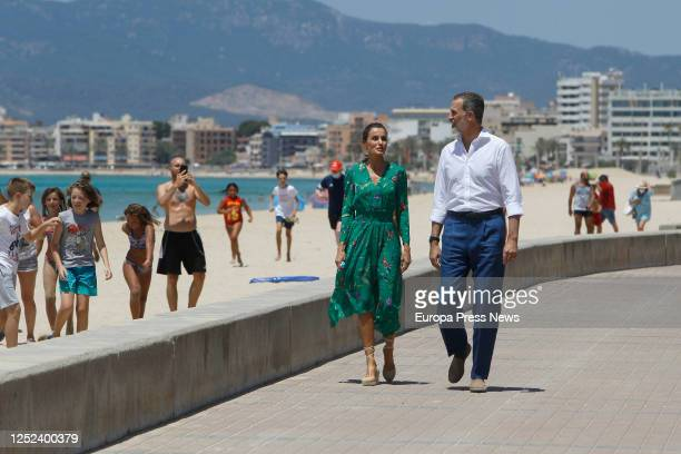 King Felipe of Spain and Queen Letizia of Spain are seen walking at Palma beach before a scheduled meeting with social agents to learn about health...