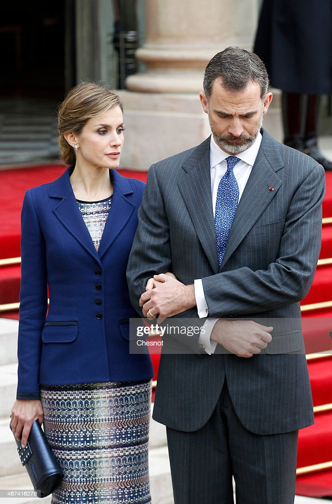 King Felipe of Spain (R) and Queen Letizia of Spain (L) listen to French president Francois Hollande as he addresses media after their meeting at the Elysee presidential palace, on March 24, 2015 in Paris, France. The King and Queen of Spain have decided to cut short their scheduled state visit to France after a Germanwings Airbus A320 plane crashed in the French Alps, as it travelled from Barcelona to Duesseldorf.