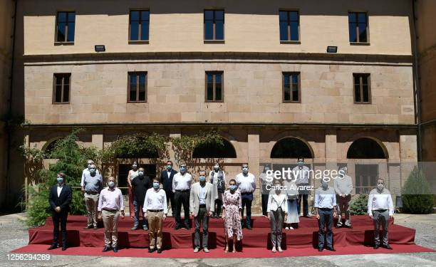King Felipe of Spain and Queen Letizia of Spain pose with delegates during a visit to Antonio Machado Secondary School on July 15 2020 in Soria Spain...