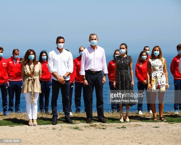 King Felipe of Spain and Queen Letizia of Spain pose with the Covadonga Royal Group of Culture the canoeist Saul Craviotto and the grass hockey...