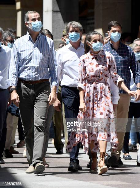 King Felipe of Spain and Queen Letizia of Spain walk through the streets wearing face masks during a visit on July 15 2020 in Soria Spain This trip...