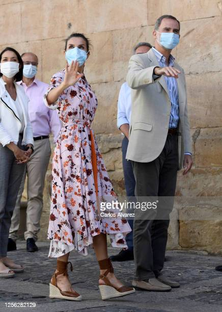 King Felipe of Spain and Queen Letizia of Spain wave to wellwishers during a visit to Antonio Machado Secondary School on July 15 2020 in Soria Spain...
