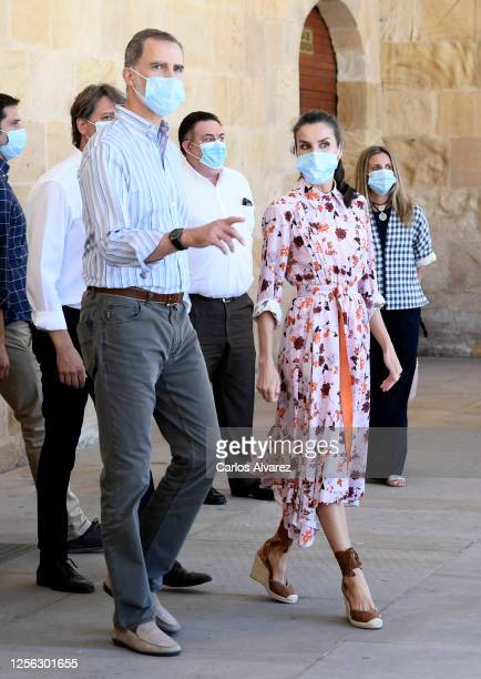 King Felipe of Spain and Queen Letizia of Spain wear face masks during a visit to a cultural centre on July 15 2020 in Soria Spain This trip is part...