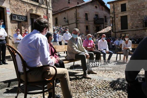 King Felipe of Spain is seen talking with some residents of the Soria town of Vinuesa on July 15 2020 in Vinuesa Soria Spain This trip is part of a...