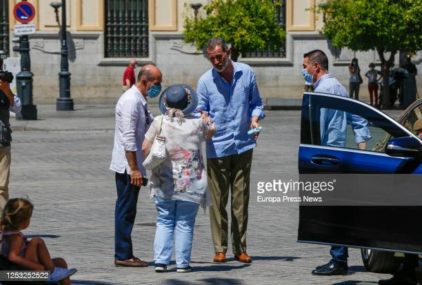 King Felipe of Spain is seen talking with two people between the Cathedral and the Royal Alcazar of Seville on June 29, 2020 in Seville, Spain. This...