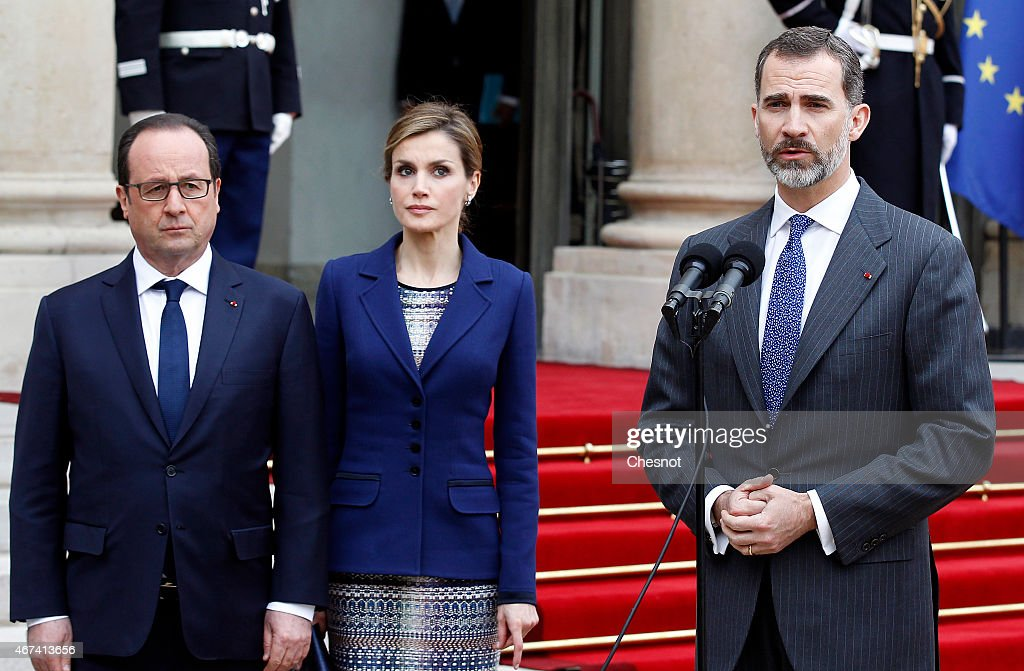 King Felipe of Spain (R) is watched by French president Francois Hollande (L) and Queen Letizia of Spain as he addresses media after a meeting at the Elysee presidential palace, on March 24, 2015 in Paris, France. King Felipe VI and Queen Letizia of Spain have decided to cut short their scheduled state visit to France after a Germanwings Airbus A320 plane crashed in the French Alps, as it travelled from Barcelona to Duesseldorf.